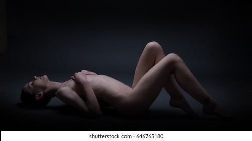 Naked woman in shadow  for concept project