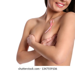 Naked woman with silk ribbon on white background, closeup. Breast cancer awareness concept