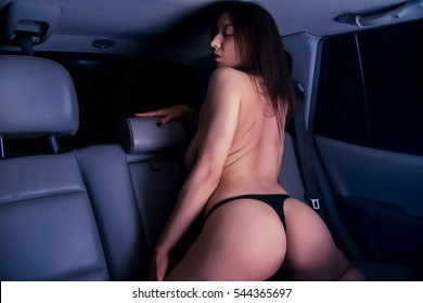 Naked woman underwear in the car