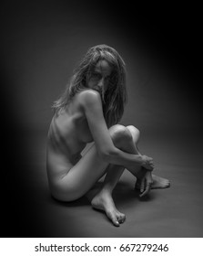 Naked woman with wild look posing on light atmosphere