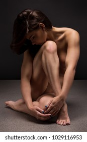 Naked woman Yoga on black background. Fine art photo of woman  body.