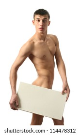 Naked young man covering with a copy space blank sign isolated on white