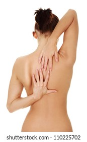 Naked young woman holding hands on her back in exercise. Brunette standing exposing back, shoulder, neck and hands and stretching back muscles . Isolated on the white background.