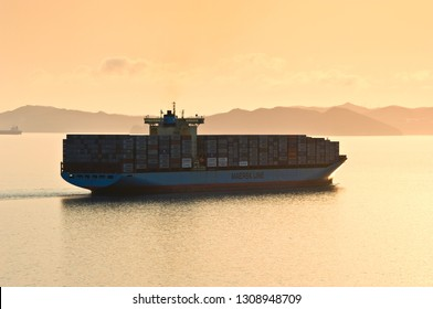 Nakhodka. Russia - April 19, 2014: Large container ship Svend Maersk coming over the sea at sunset.