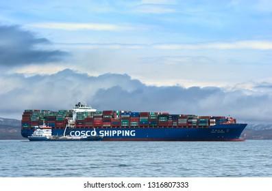 Nakhodka, Russia- April 19, 2017: Bunkering tanker Zaliv Nakhodka container ship CSCL Spring.