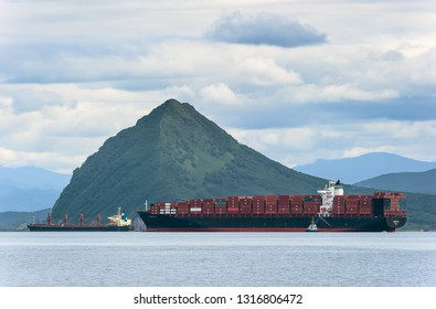 Nakhodka. Russia - August 11, 2017: Container ship Hamburg Bay at anchor in the roads.