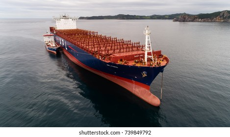 Nakhodka. Russia - August 11, 2017: Bunkering tanker Zaliv Nakhodka a large container ship APL Paris.