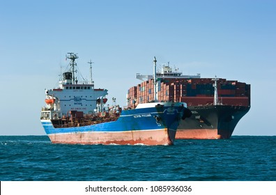 Nakhodka. Russia - August 30, 2017: Tanker Ostrov Russkiy after bunkering passes by container ship ZIM San Diego.