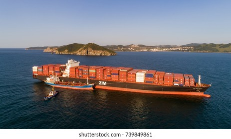 Nakhodka. Russia - August 30, 2017: Bunkering tanker Ostrov Russkiy a large container ship ZIM San Diego.