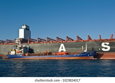 Nakhodka, Russia - February 01, 2018: Tanker Zaliv Petra Velikogo bunker container ship of the company UASC standing in the roadstead of the winter sea.