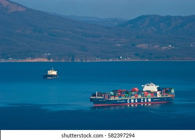 Nakhodka, Russia- February 14, 2017: Container ship CMA CGM La Scala standing on the roads at anchor.