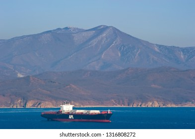 Nakhodka, Russia- February 18, 2019: Container ship APL Thailand standing on the roads at anchor.