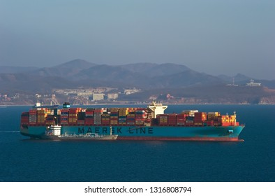 Nakhodka, Russia- February 18, 2019: Bunkering tanker Taurus a large container ship Maersk Elba.