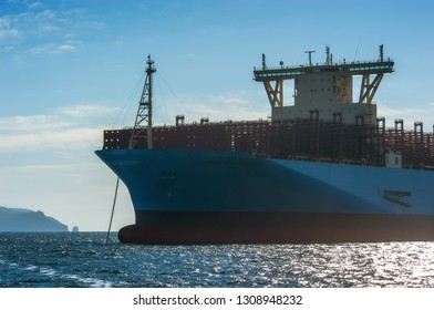 Nakhodka, Russia - January 12, 2019: The bow of a huge container ship Maastricht Maersk at anchored in the roads.