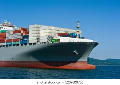 Nakhodka. Russia -July 06, 2016: The bow of the container ship COSCO Fortune standing on the roads at anchor.