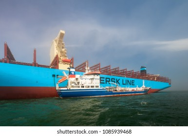 Nakhodka, Russia - July 12, 2017: Tanker Zaliv Nakhodka bunkers in the raid a large container ship company Maersk.