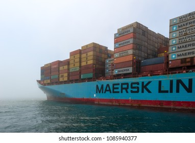 Nakhodka, Russia - July 12, 2017: The container ship of the company Maersk is anchored not by the raid on a foggy day.