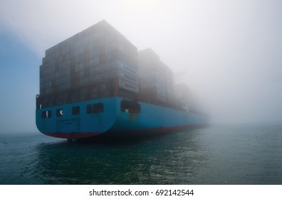 Nakhodka, Russia - July 12, 2017: Container ship Maersk Altair stands in the fog in the roadstead.