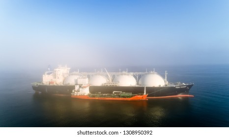 Nakhodka, Russia - July 28, 2017: Tanker RN-Polaris is engaged in bunkering LNG-tanker Energy Progress is anchored in the road.
