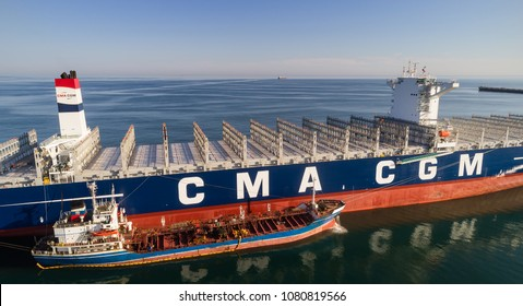 Nakhodka. Russia - July 29, 2017: Bunkering tanker Ostrov Russkiy a large container ship CMA CGM J. Adams.