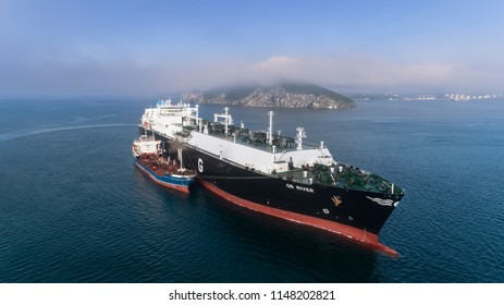 Nakhodka. Russia - July 29, 2018: Tanker Ostrov Russkiy is engaged in bunkering LNG-tanker Ob River is anchored in the road.