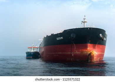 Nakhodka, Russia - June 07, 2018: Tanker Zaliv Nakhodka on the roadstead bunkering supertanker Desimi.