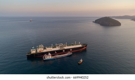 Nakhodka, Russia - June 22, 2017: Tanker Zaliv Nakhodka is engaged in bunkering LNG-tanker Ob River is anchored in the road.