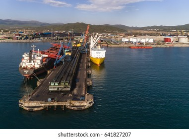 Nakhodka, Russia - May 16, 2017: Bulk carrier GNS Hore and vessel for transportation of large cargoes Happy Sky are in the port near the coal terminal.