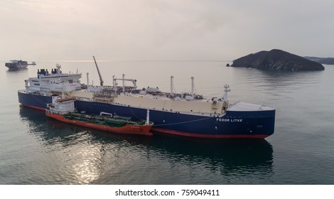 Nakhodka, Russia - November 13, 2017: Tanker RN-Polaris is engaged in bunkering LNG-tanker Fedor Litke is anchored in the road.
