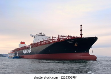 Nakhodka. Russia - October 19, 2017: Bunkering tanker Zaliv Nakhodka a container ship Unayzah.