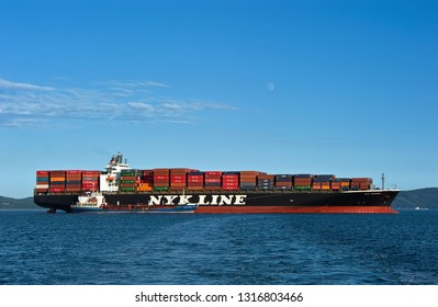 Nakhodka. Russia - September 02, 2017: Bunkering tanker Ostrov Russkiy a large container ship NYK Aquarius.