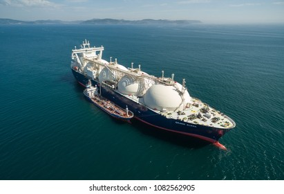 Nakhodka. Russia - September 07, 2017: Tanker Zaliv Vostok is engaged in bunkering LNG-tanker Grand Elena is anchored in the road.