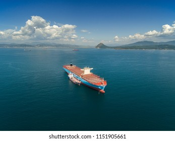Nakhodka. Russia - September 07, 2017: Bunkering tanker Zaliv Nakhodka a large container ship Maersk Honam.