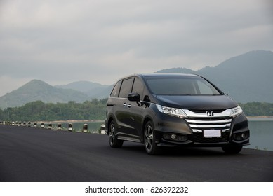 NAKHON NAYOK, THAILAND -APRIL 23 2017: Private MPV Honda Odyssey  Photo at  NAKHON NAYOK DAM from Nakorn Nayok,Thailand