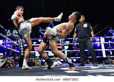 NAKHON NAYOK, THAILAND- APRIL 4, 2014 : Boys boxers compete in the Championship Thai Fight : Muay Thai World's Unrivalled Fight on APRIL 4, 2014 at Nakhon Nayok Provincial Stadium, Thailand.