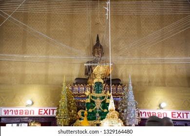 NAKHON NAYOK, THAILAND - JANUARY 18 : Thai people traveler respect praying and visit for blessing from Luang Phor Pak Daeng buddha statue at Wat Prommanee on January 18, 2017 in Nakhon Nayok, Thailand