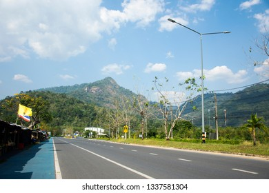 NAKHON NAYOK, THAILAND - JANUARY 18 : Thai people driving car on the road at countryside with local shop for people  shopping at beside road on January 18, 2017 in Nakhon Nayok, Thailand