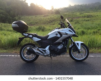 Nakhon Nayok, Thailand. May 19, 2019 : Sunday morning which is a holiday traveling with motorcycle Big Bike Honda NC750X white color in Khao Yai National Park.