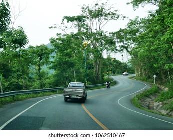 NAKHON NAYOK, THAILAND - MAY 9 : Travelers thai people driving car go to visit Khun Dan Prakan Chon Dam was formerly named Khlong Tha-Dan Dam while rain strom on May 9, 2017 in Nakhon Nayok, Thailand