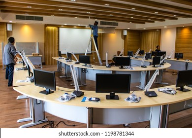 Nakhon Pathom Province, Thailand - September 12, 2017 : The technicians are installing and testing new electronic audiovisual equipment and new black monitors in the auditorium or meeting room