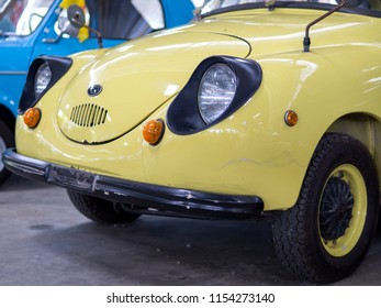Nakhon pathom, THAILAND - August 03, 2018 : Classic car headlights close-up, yellow vintage car. Exhibition