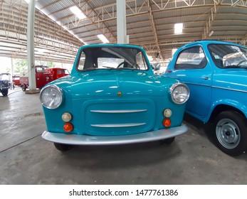 Nakhon Pathom, Thailand - August 3, 2019: Vintage car Piaggio Vespa 400 exhibit at vintage car collector garage in Nakhon Pathom province