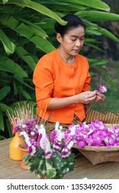 NAKHON PATHOM, THAILAND- December 3, 2013: A traditional flower making exhibit at the Sampran Riverside.