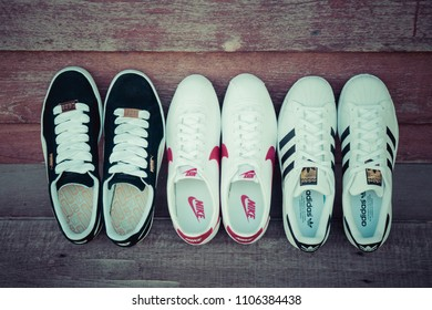 NAKHON PATHOM, THAILAND - DECEMBER 30, 2017 : Adidas superstar white/black shoes, Nike classic cortez leather white/varsity red - blance/varsity rouge and Puma suede black/white with popular fashion.
