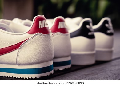 NAKHON PATHOM, THAILAND - DECEMBER 30, 2017 : Adidas superstar white/black shoes and Nike classic cortez leather white/varsity red - blance/varsity rouge with popular fashion thailand.
