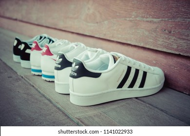 NAKHON PATHOM, THAILAND - DECEMBER 30, 2017 : Adidas superstar white/black shoes, Nike classic cortez leather white/varsity red - blance/varsity rouge and Puma suede black/white with popular fashion.