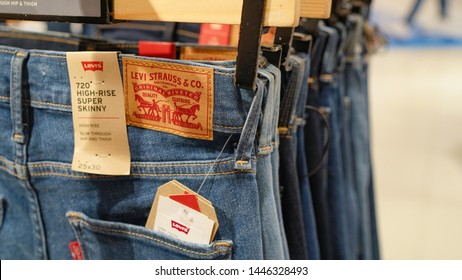 Nakhon Pathom, Thailand - July 9, 2019 : Levi Strauss label on a pair of blue jeans. Levi Strauss is one of the world's oldest and most well known jeans manufacturer
