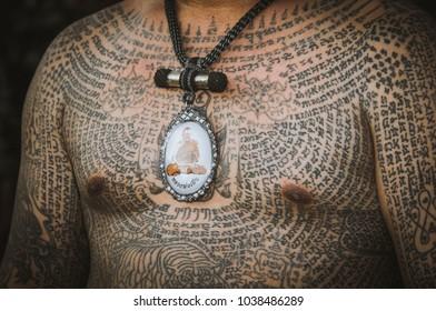 Nakhon Pathom / Thailand - March 3rd 2018:  Sak Yant Festival at Bang Phra. A close up of a tattoed chest
