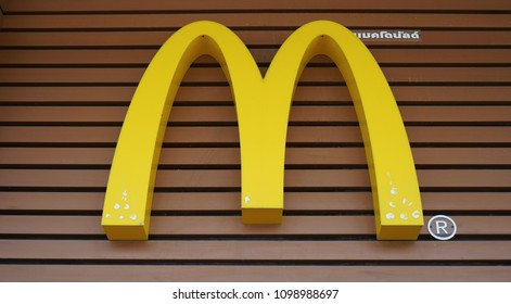 Nakhon Pathom, Thailand - May 26, 2018 :  McDonald's restaurant logo on a wooden decor background. McDonald's Corporation is the world's largest fast food restaurants.