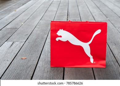 NAKHON PATHOM, THAILAND-DECEMBER 30, 2017:A bag puma on floor .PUMA SE is a German multinational company that designs and manufactures athletic and casual footwear, apparel and accessories